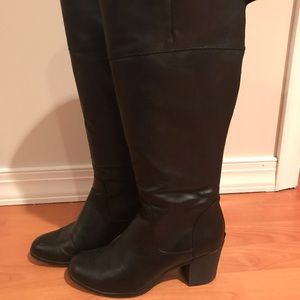 Tall black white mountain high boots
